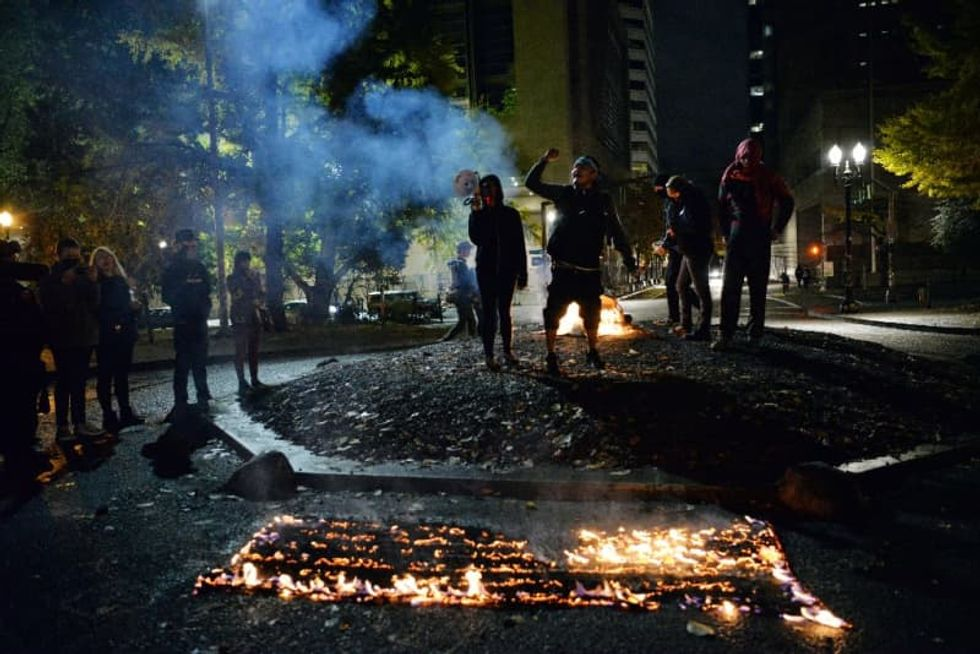 Portland police face off with progressive protesters in Wednesday night 'riot'