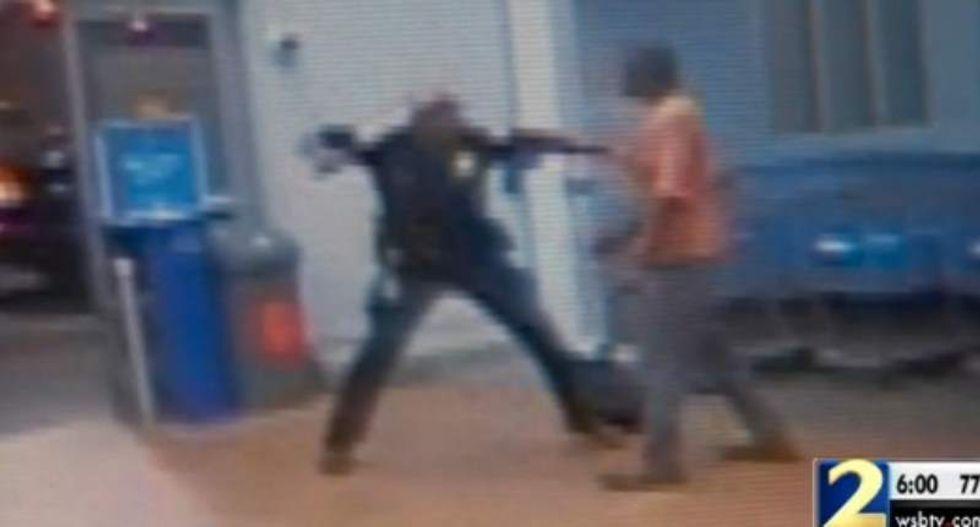 Atlanta cop in 'Robocop mode' caught on tape breaking man's leg -- over a Walmart tomato