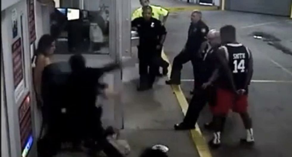 WATCH: Rookie cop brutally beats handcuffed woman pinned to wall -- as other officers watch
