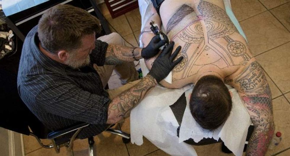 Sailors rush for tattoos as Navy eases rules to help draw younger recruits