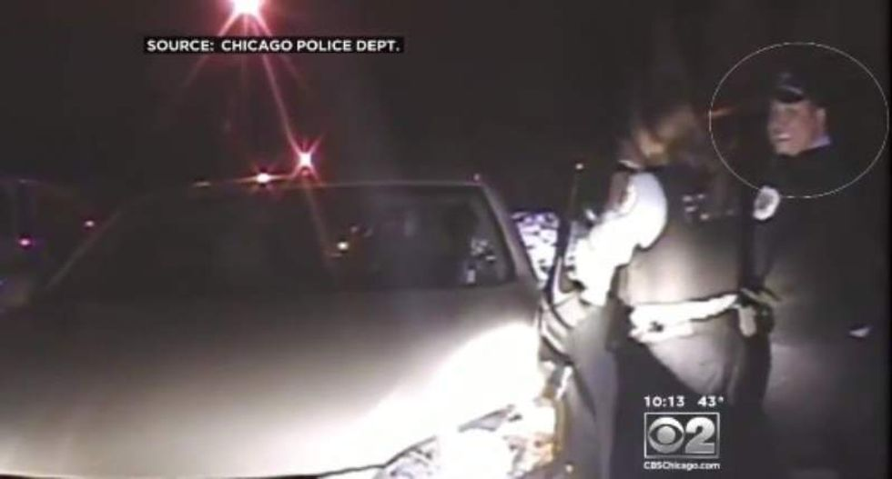 Dashcam video shows Chicago cop smiling while attacking reverend with kids in her car