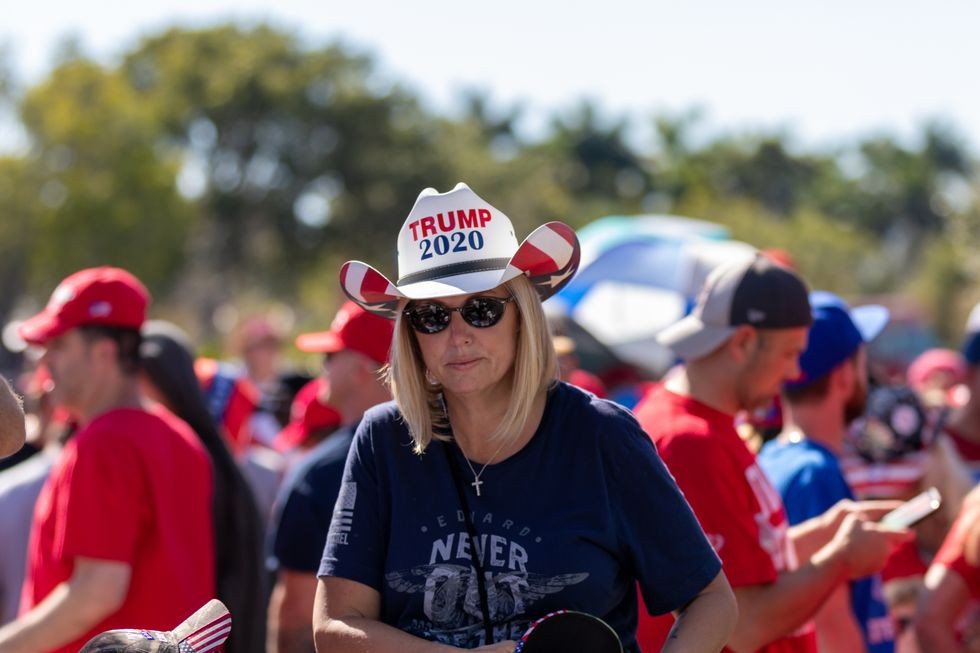 Flag-waving Trump supporters block California voting station with vehicle caravan