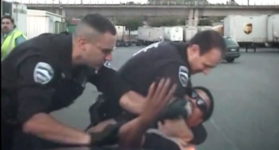 WATCH: Cops hold man down and sic K-9 on him after beating him -- for dancing in a parking lot