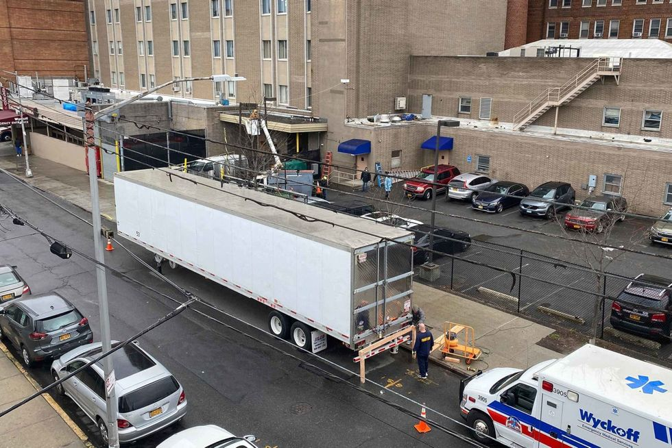 'A conveyor line of bodies': Unthinkable scenes unfold in New York City as corpses are loaded into a refrigerated truck