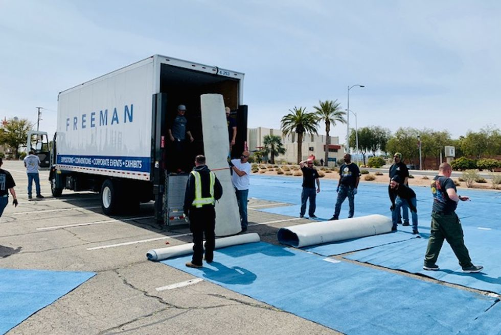 As thousands of Las Vegas hotel rooms sit empty, city paints 'social distancing boxes' in parking lot for homeless people