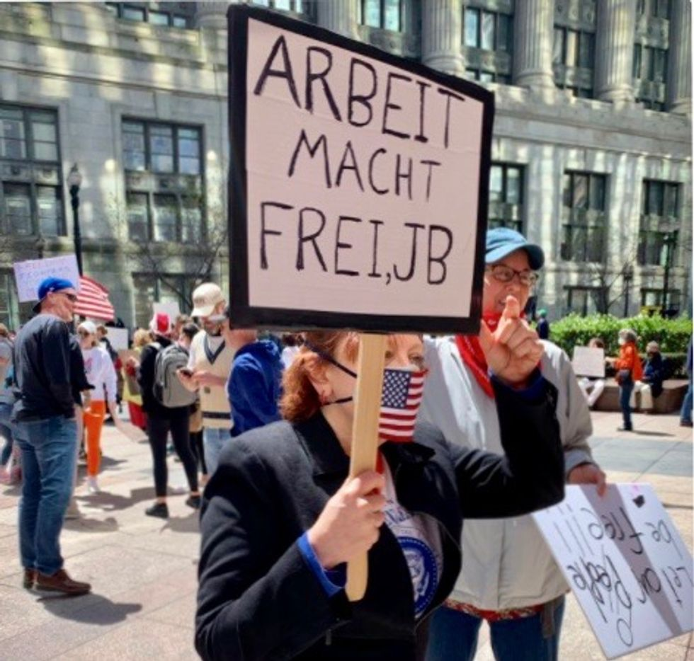 'Heil, Pritzker': Right-wing anti-quarantine protestors in Illinois carry Nazi signs against the Jewish governor