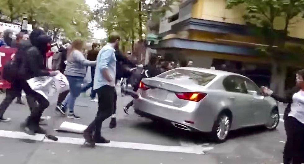 Portland man admits making vulgar gesture before before driving his Lexus through crowd of Black Lives Matter protestors