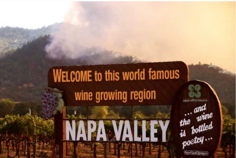 Wildfires rip through California wine country, thousands flee homes