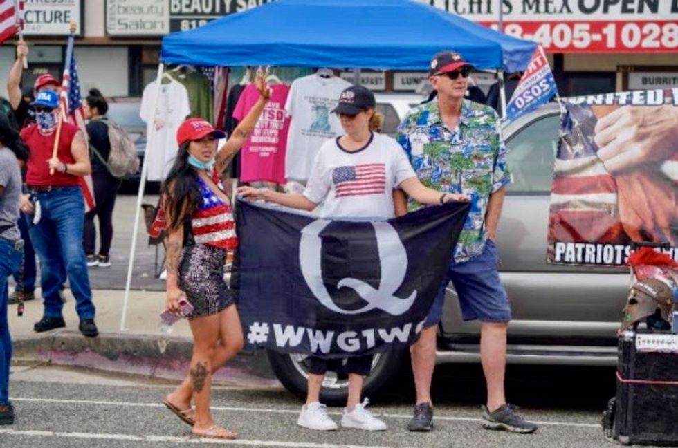 Trumpworld 'going all in on QAnon' with the election less than 2 weeks away: report