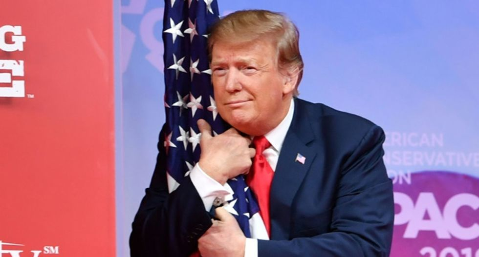 White House sparks outrage with 'disturbing' photo of Trump 'molesting' US flag to celebrate Flag Day