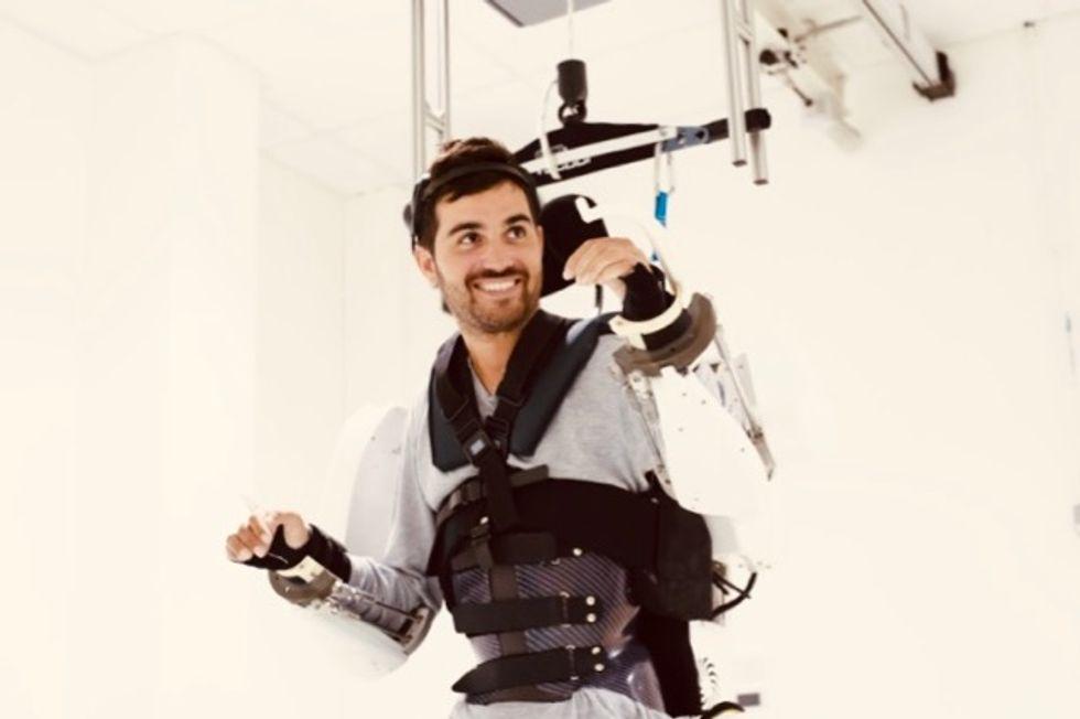 Paralyzed man walks again with brain-controlled exoskeleton