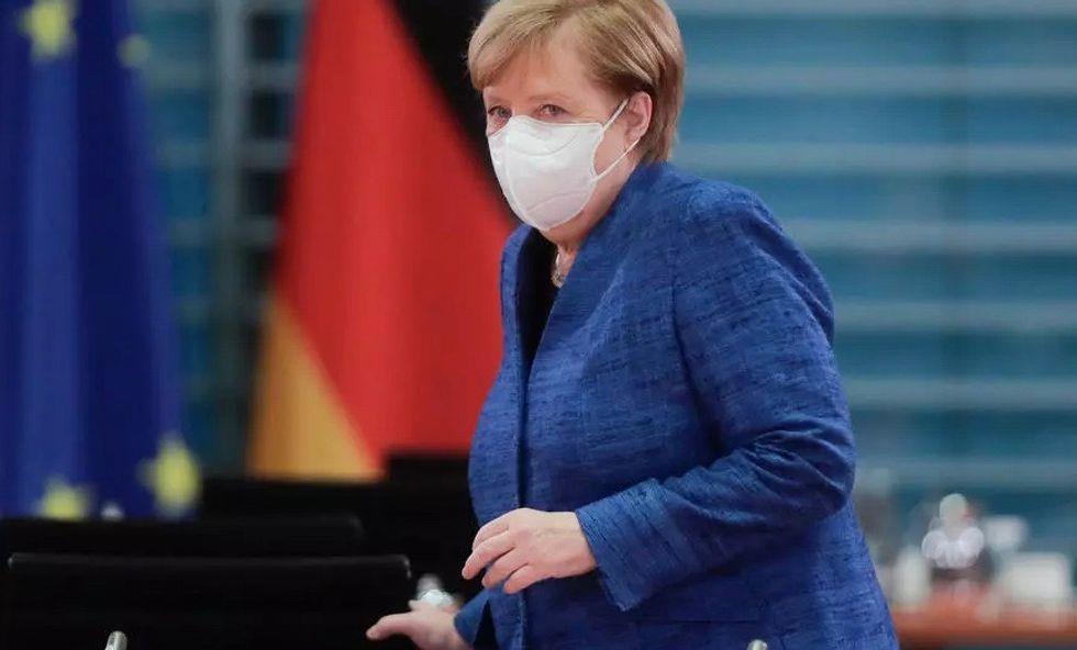 Merkel eyes 'lockdown light' to tame virus