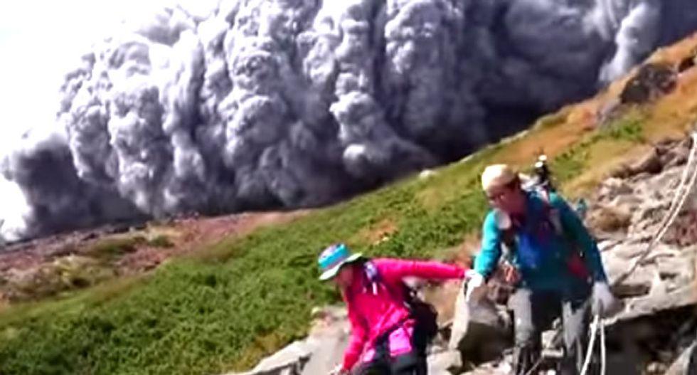 Terrifying images as Japanese volcano erupts, sending ash clouds at scrambling hikers