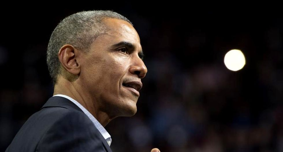 On Christmas visit with troops, Obama lauds end of Afghanistan mission