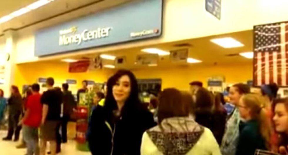 WATCH: Walmart manager threatens to call cops on 'flash mob' of teen Christmas carolers