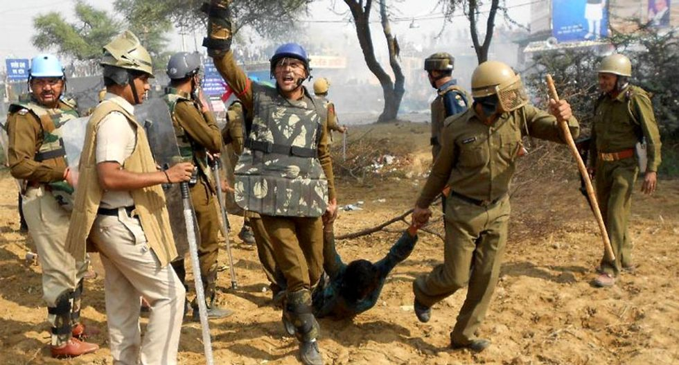 Indian police clash with armed followers of wanted 'godman'