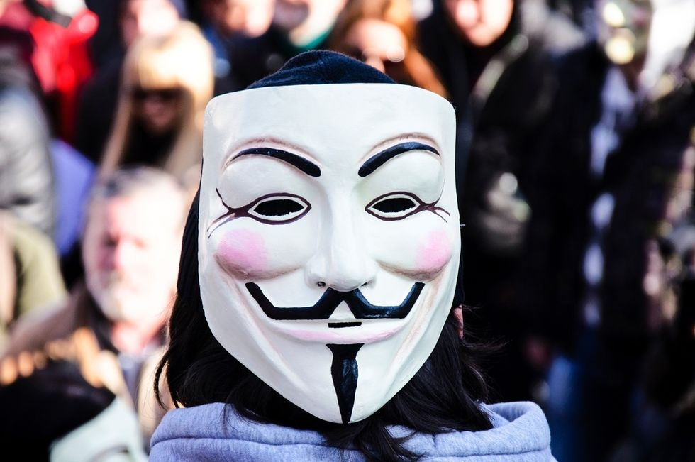 'Let the war begin': Anonymous knocks hate sites offline as KKK 'hoods off' campaign continues