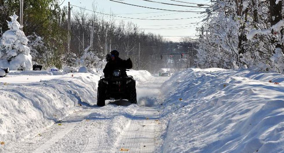 Blizzard-weary Americans brave more snow as eight die