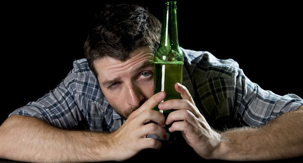 Can you drink huge amounts of booze without becoming an alcoholic?