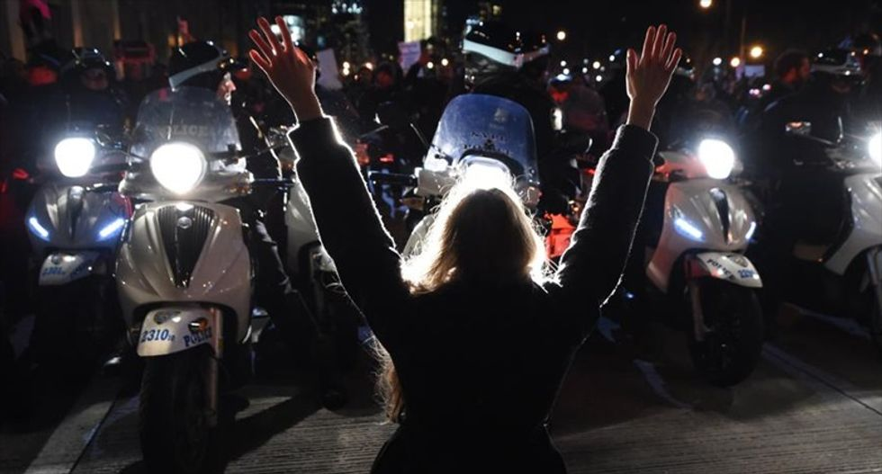 Anti-police protesters in Oakland break windows, trash Christmas tree