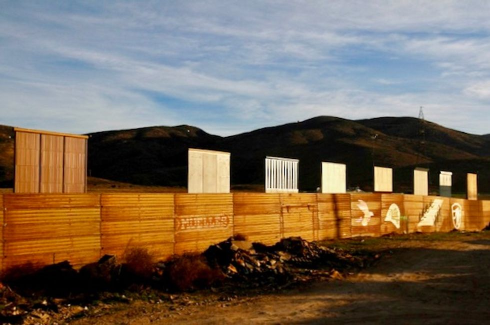 Trump says will go forward with border wall plans in California