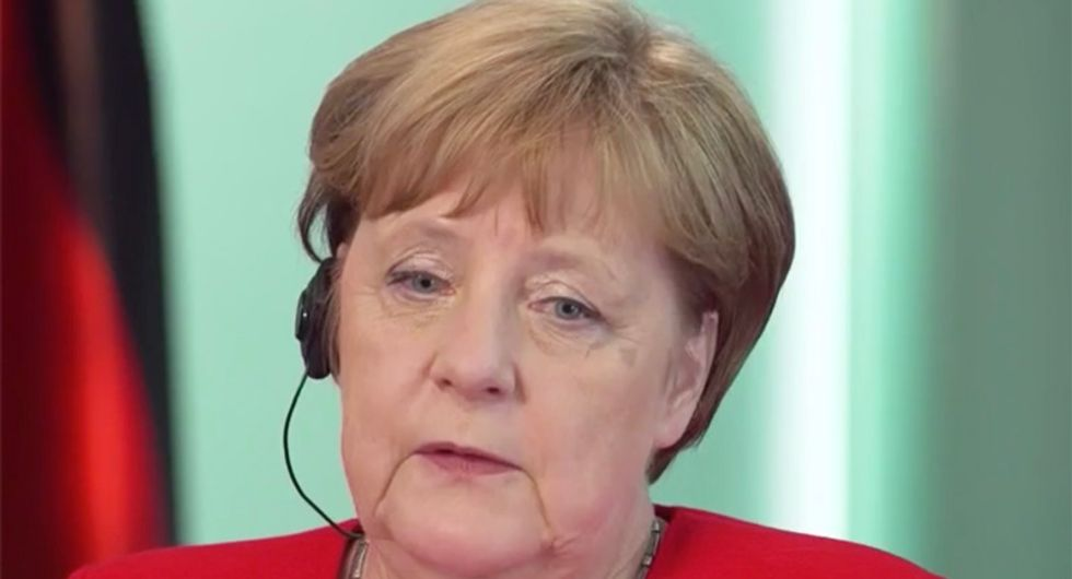 WATCH:  Germany's Angela Merkel sounds the alarm on rise of right-wing 'dark forces' in Europe and America