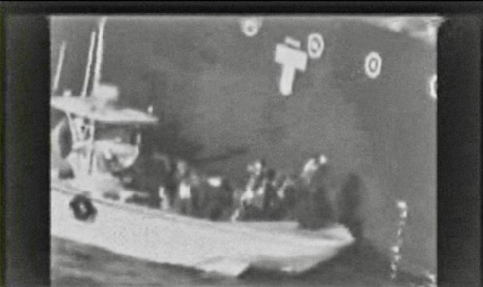 US releases grainy video of 'Iran forces' next to tanker