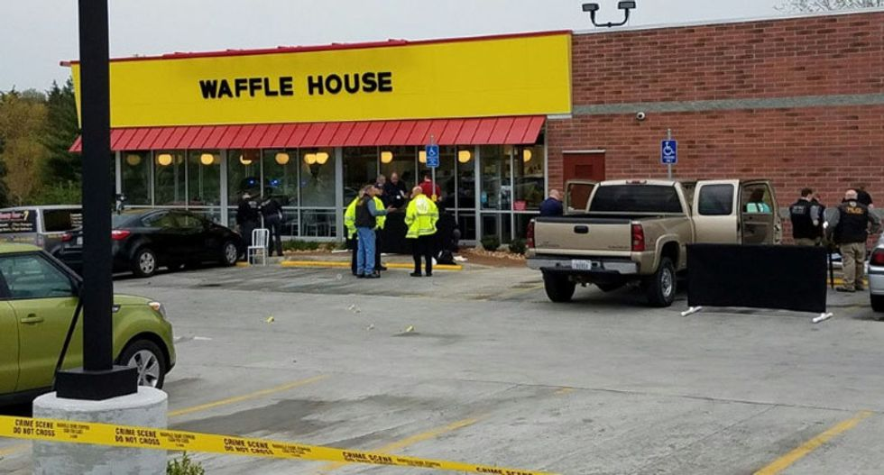 Police hunt for Waffle House gunman who was disarmed by hero after 4 killed