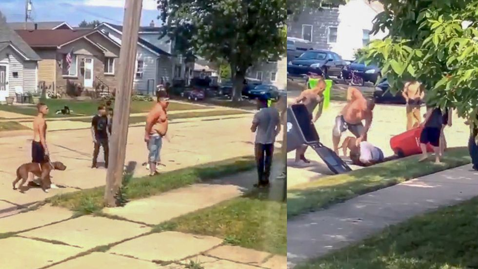 WATCH: Gang of white people release dog to viciously attack black man during fistfight