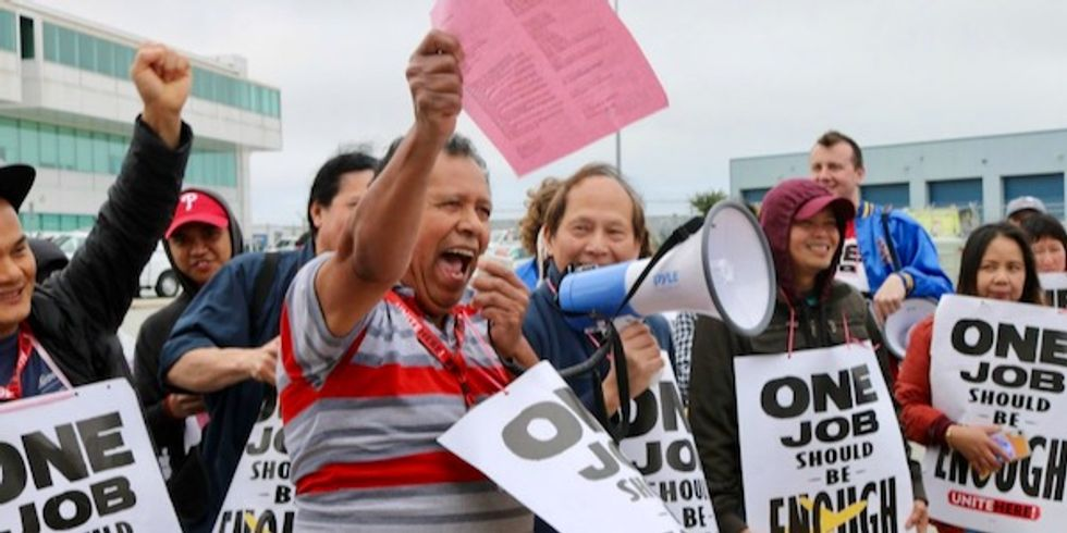 'We won't back down': Over 50 catering workers arrested at American Airlines HQ in protest against poverty wages
