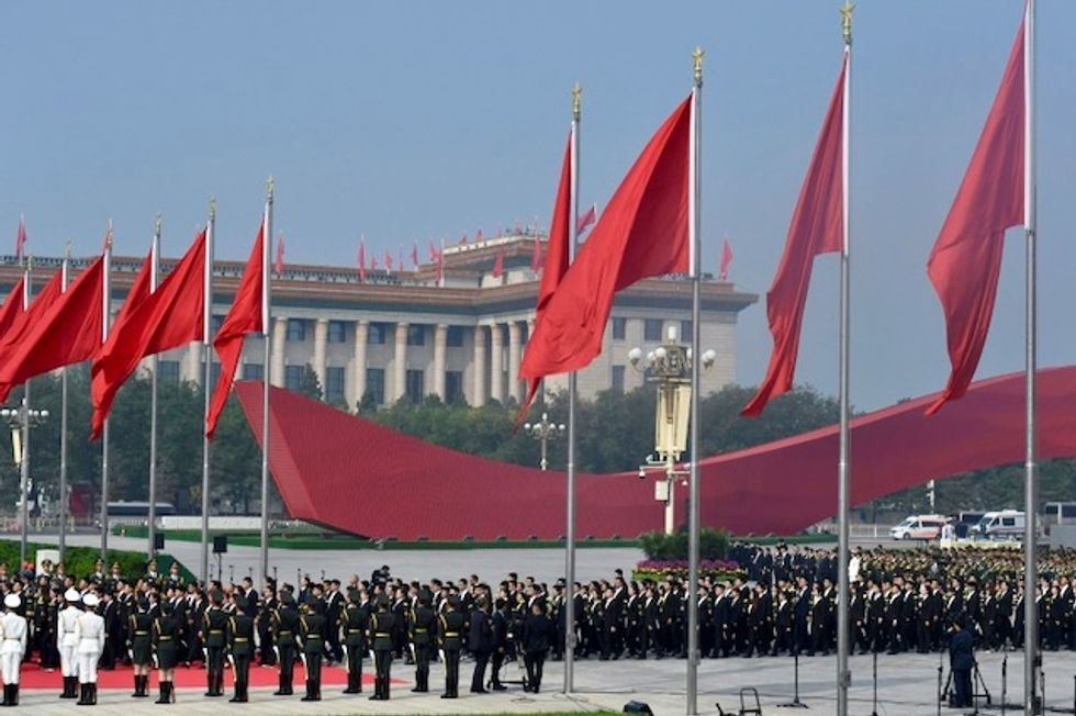 China readies for anniversary, Hong Kong for protest