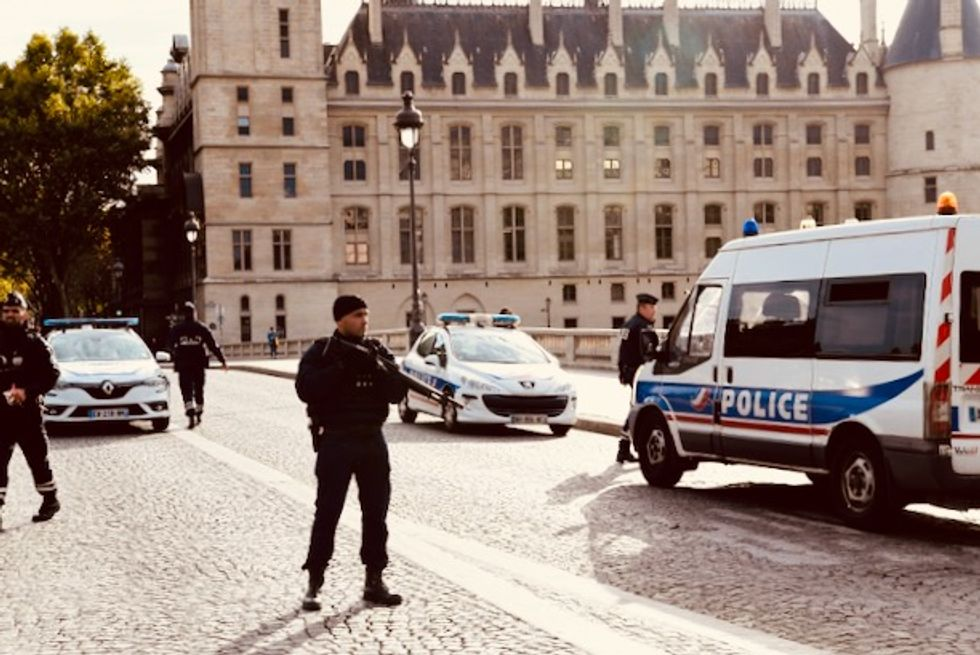 Hunt for motive of staffer who killed four at Paris police HQ