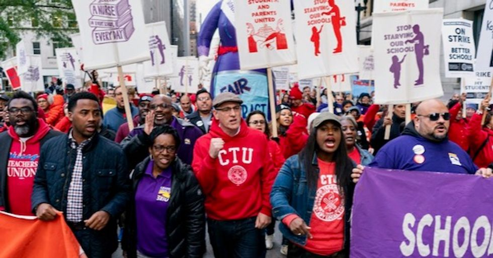Demanding 'pay and benefits that give us dignity,' 25,000 Chicago public school teachers go on strike