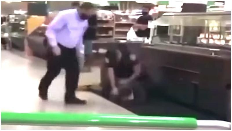 'Beating him to death for a chicken': Local residents horrified after videos shows cop pummeling homeless man in grocery store