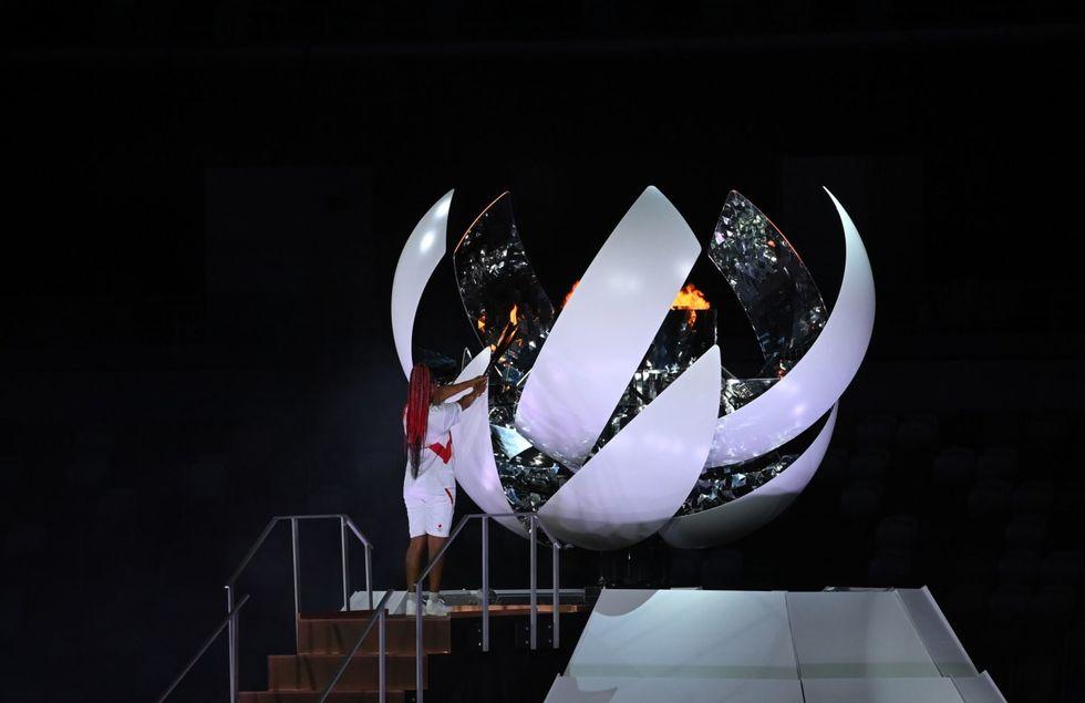 Tennis star Naomi Osaka lights Olympic cauldron at Tokyo opening ceremony