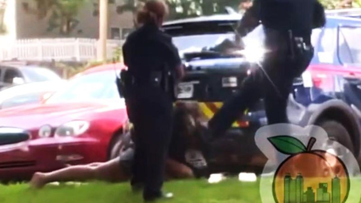 Family 'horrified' after video shows cop kicking woman in the face as she lies handcuffed on the ground