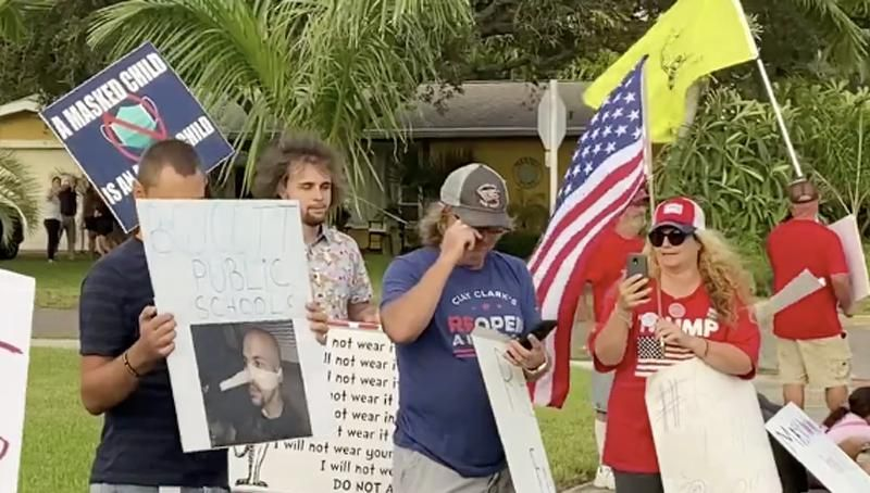 Anti-mask protesters show up at Florida school board member's home and cough in her face