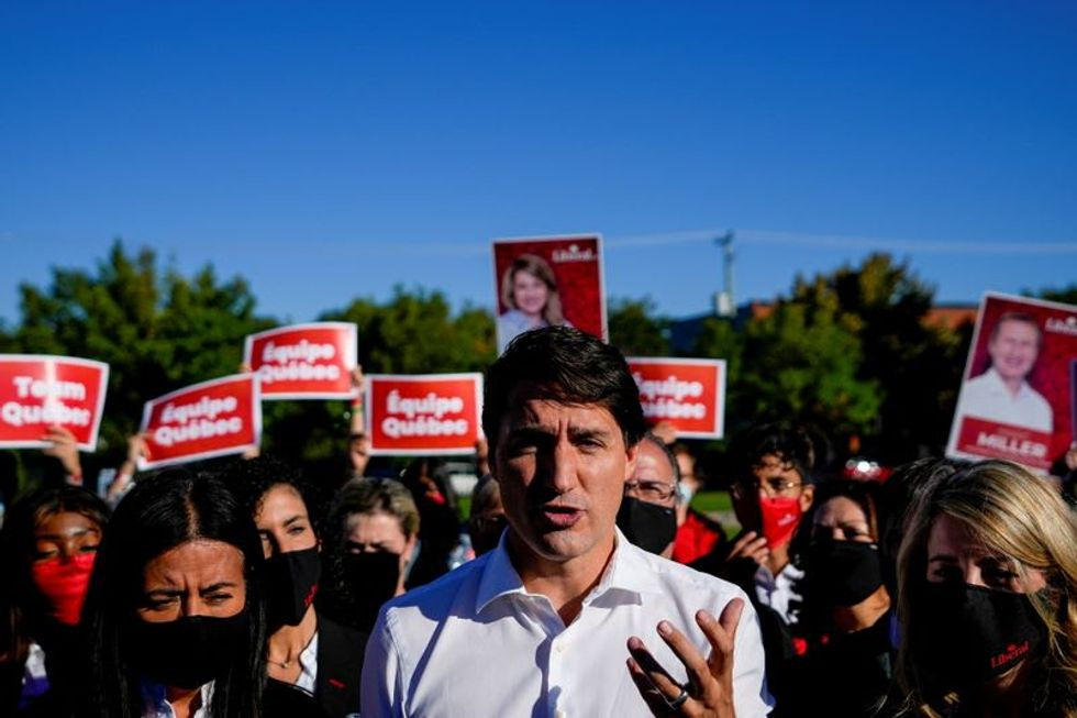 Canada's Trudeau hammers rival over COVID-19 stance on last day of campaign