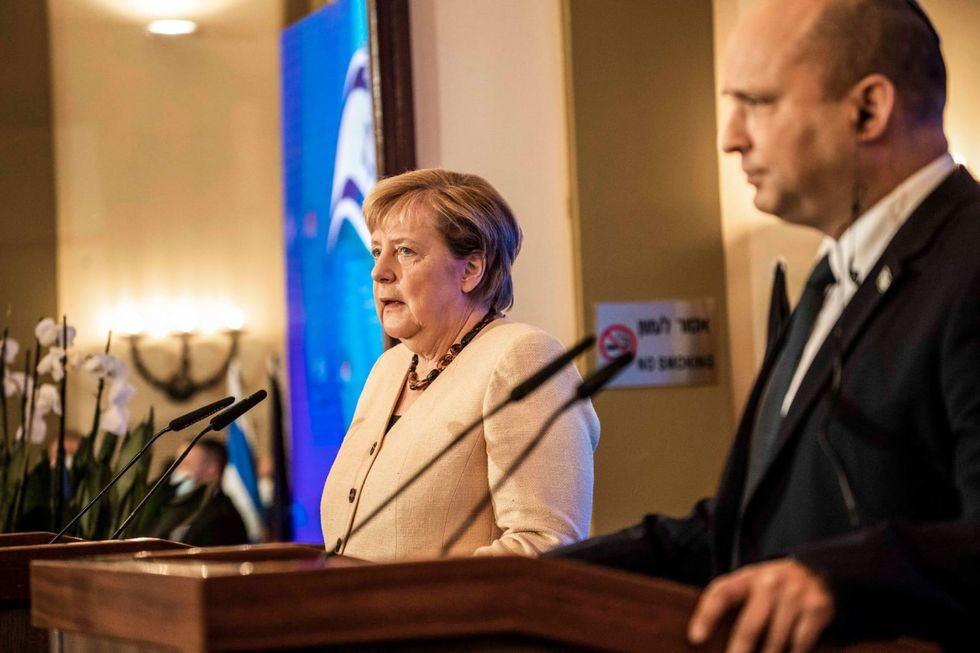 Merkel says Germany bears responsibility for Israel as she meets PM