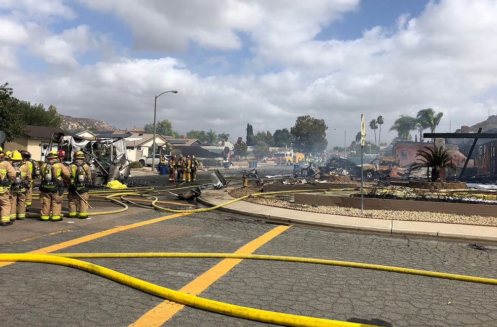 2 dead after plane crashes into home and UPS truck in San Diego County city of Santee