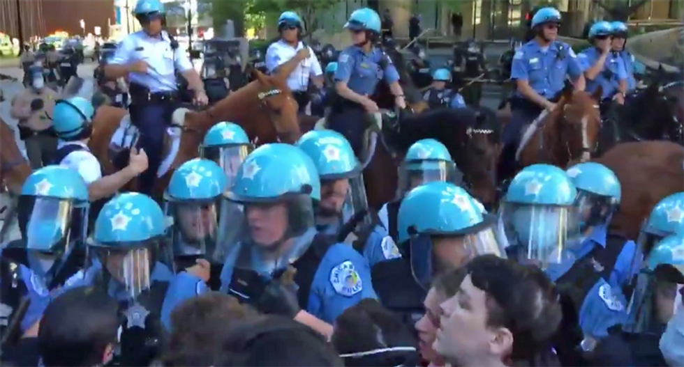 Trump Tower is 'under siege' as Chicago Police make arrests to defend the president's building