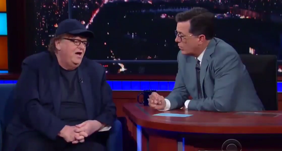 'They see him as their human molotov cocktail': Michael Moore tells Colbert why he knew Trump would win