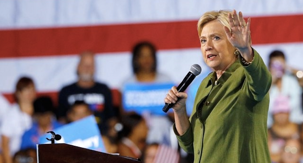 Clinton happily yields national spotlight to Trump as his poll numbers plummet