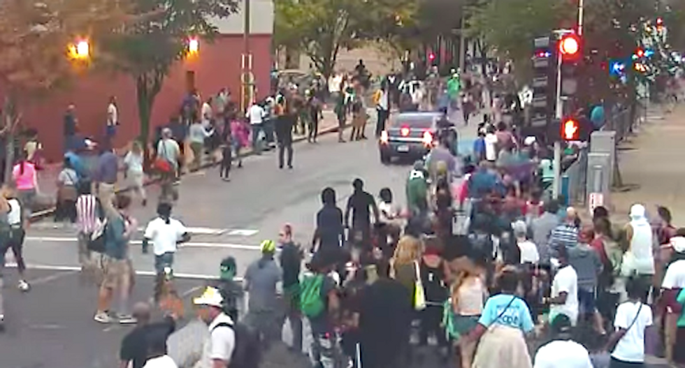 WATCH: Protesters scatter as St. Louis cops drive unmarked car in reverse through crowd
