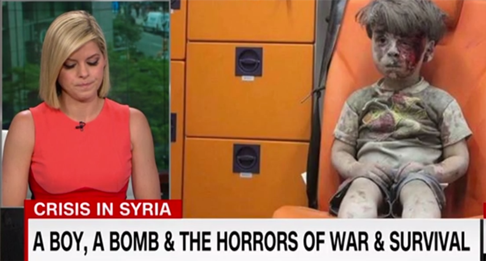 CNN's Kate Bolduan struggles to hold back tears while covering boy who barely survived Syria bombing