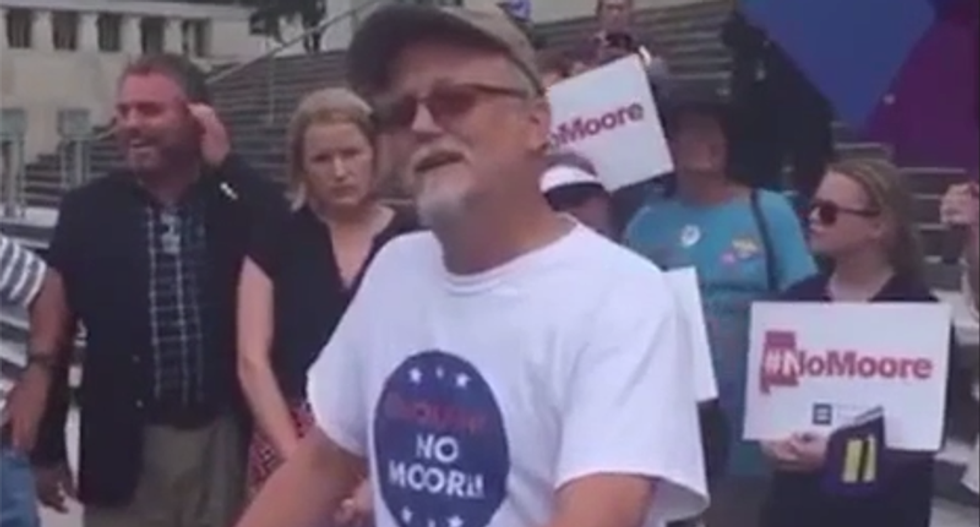 Christian protester heckles grieving gay man speaking about late husband: 'You can't have a husband'