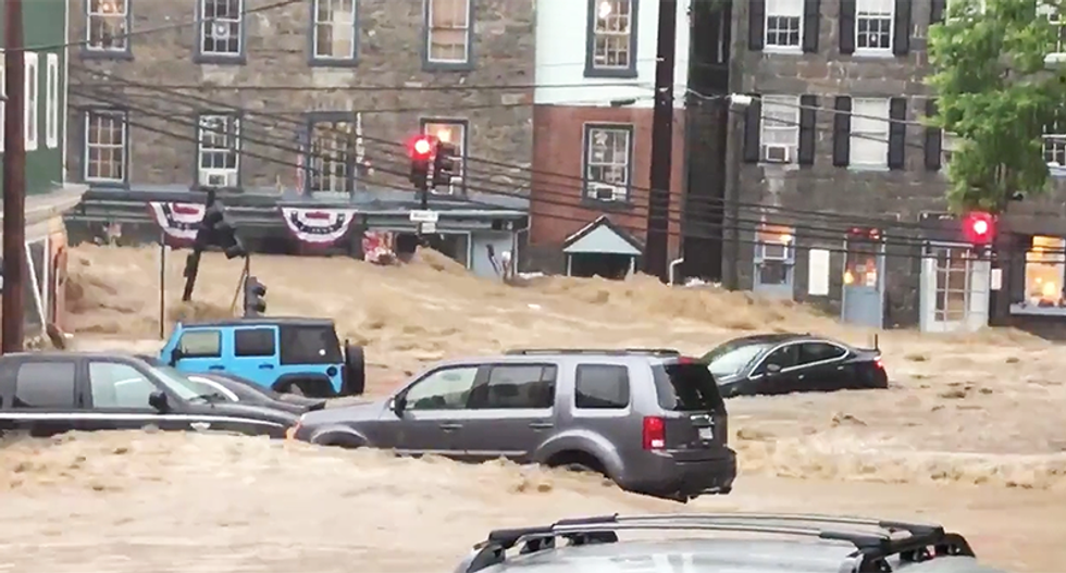 17 horrifying photos and videos of 'wall of water' in Ellicott City, Maryland as flood waters carry away cars