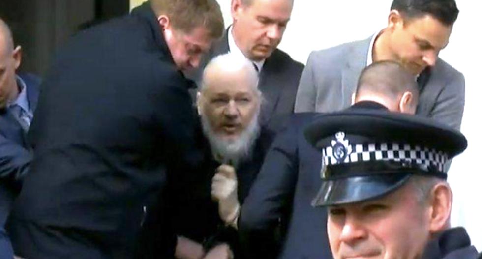 Julian Assange arrested in London after Ecuador withdraws his asylum