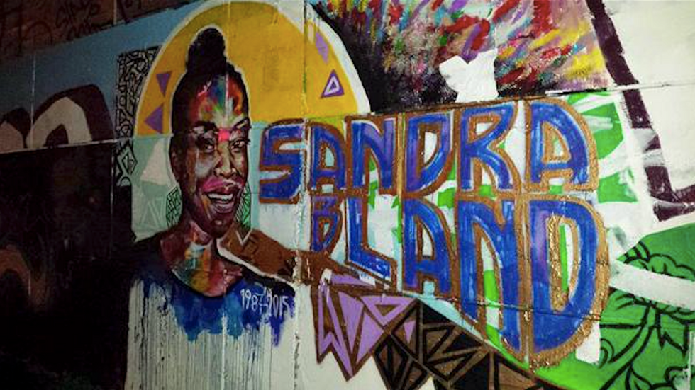 Artists restore Sandra Bland mural after vandals write 'All lives matter' on it