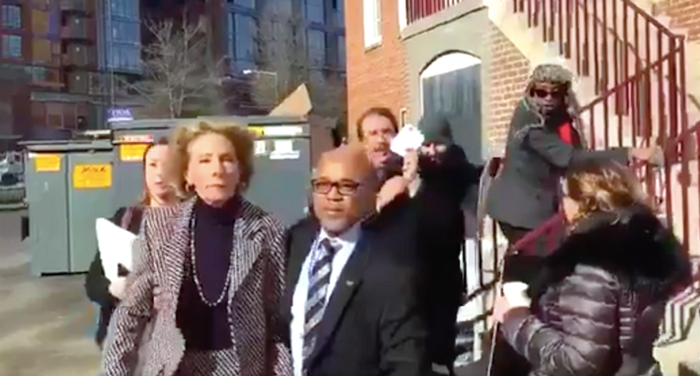 WATCH: Betsy DeVos quickly gives up and leaves DC school after a couple of protesters block her path